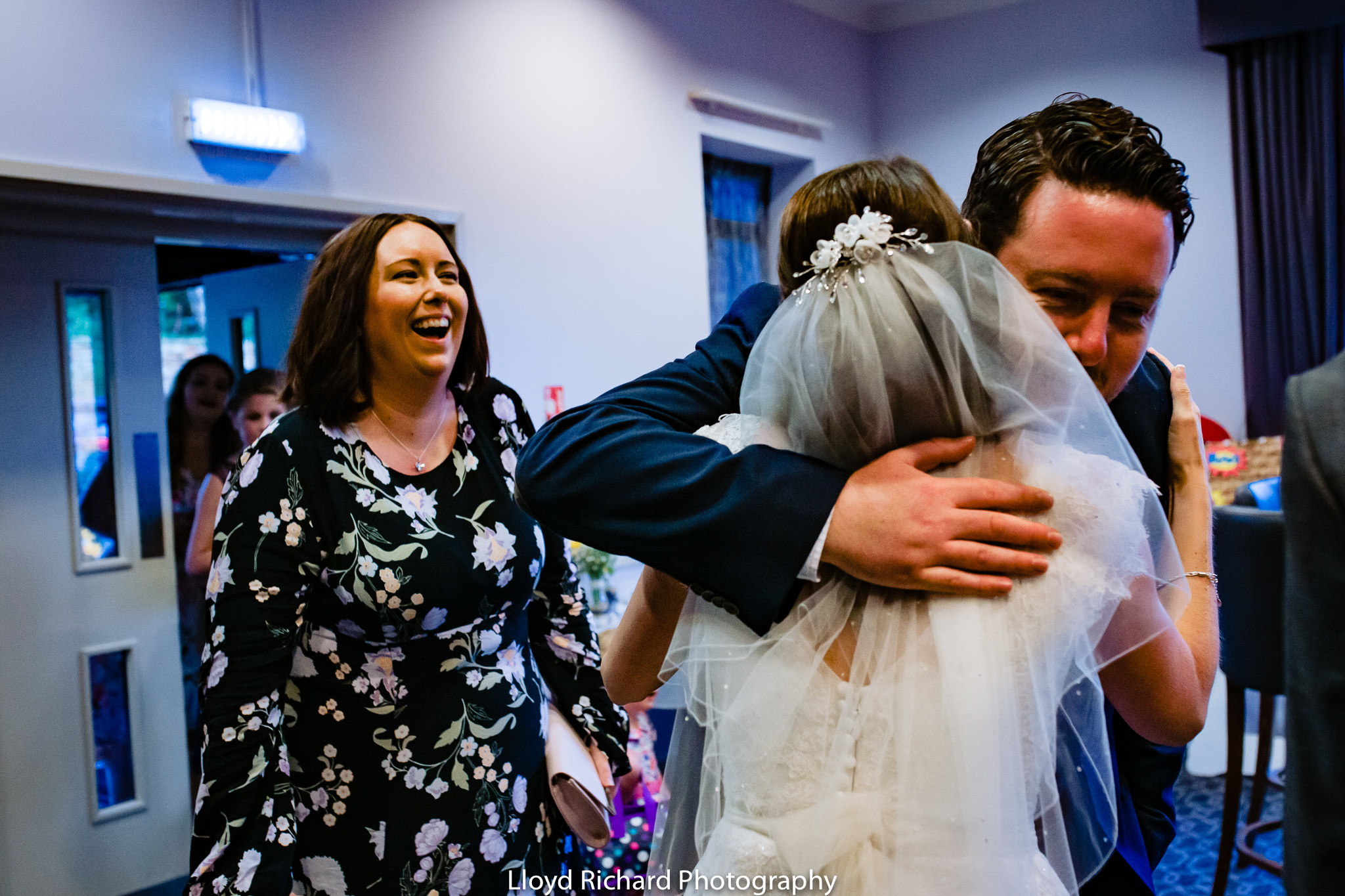 wedding hugs at De Vere New Place Shirrell Heath