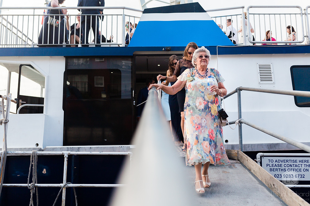 mother of the bride leaving the boat