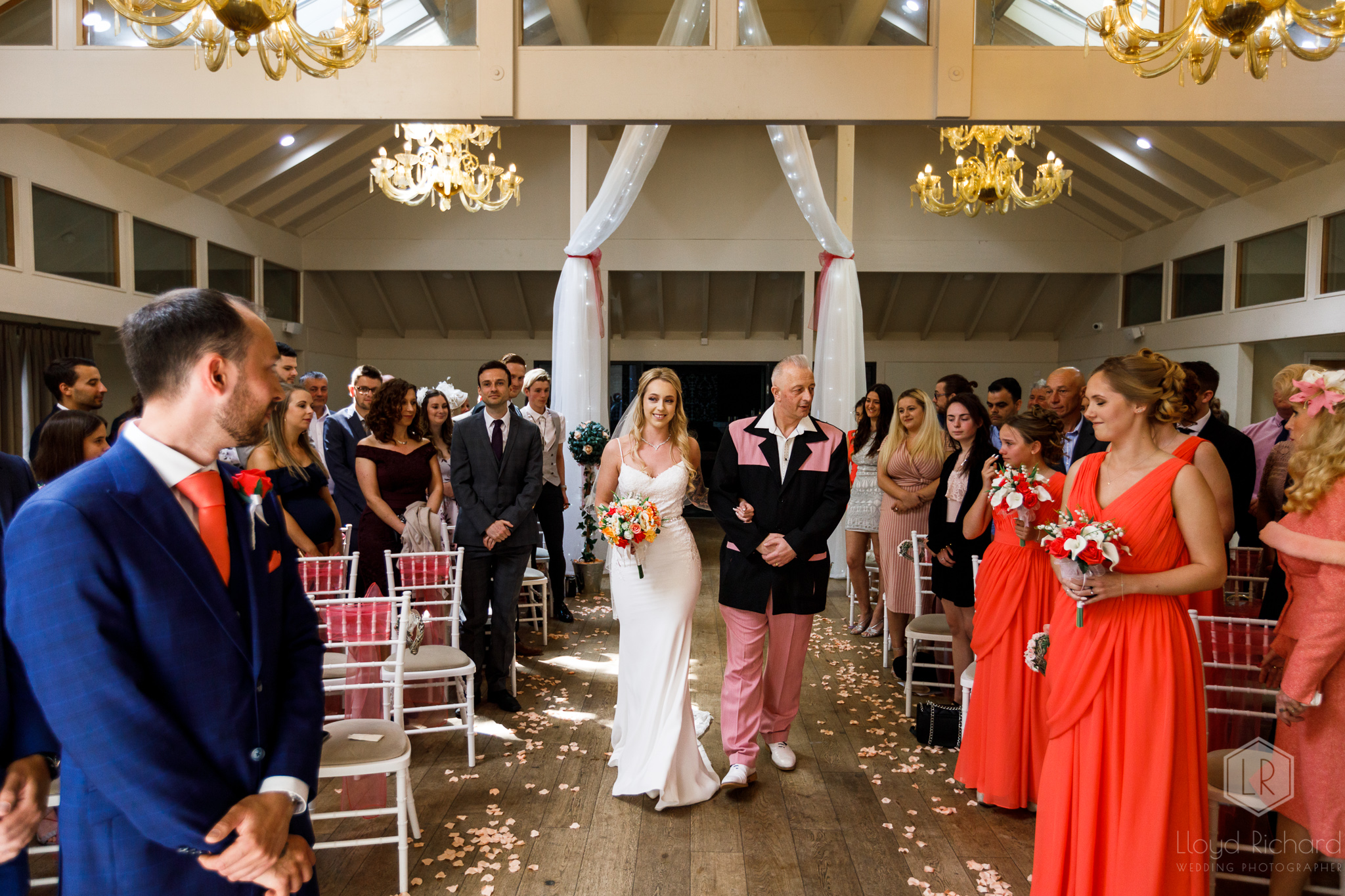 Bride walking down the aisle at marwell hotel