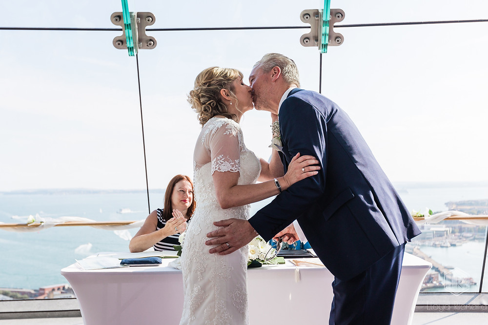 First kiss at spinnaker tower wedding