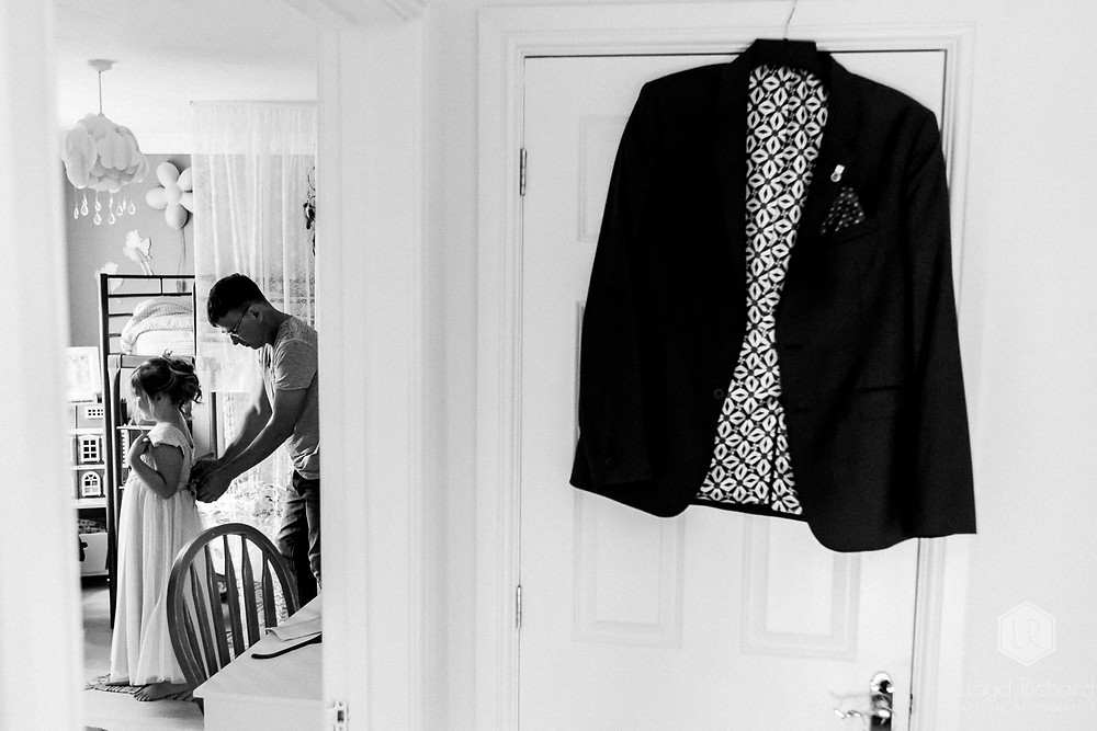 father dressing his daughter before the wedding