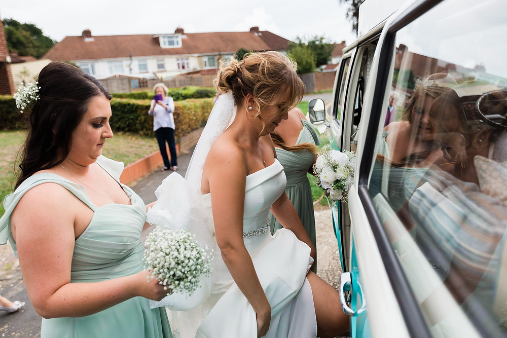 bride getting into the VW camper for her wedding
