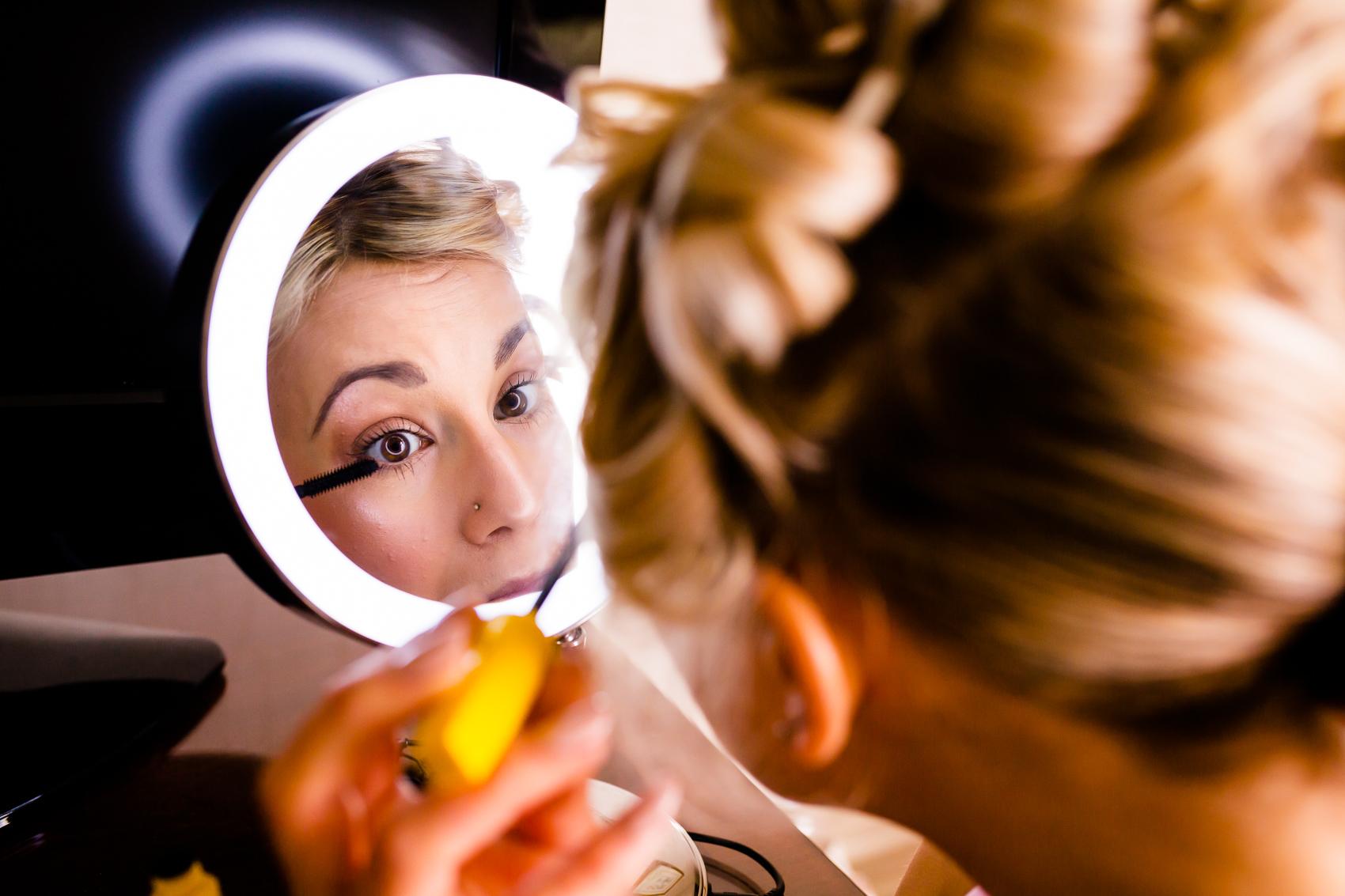 bridesmaid putting on make up