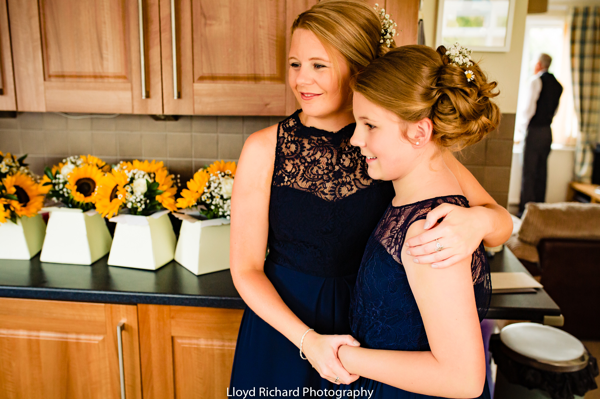 Bridesmaids hugging