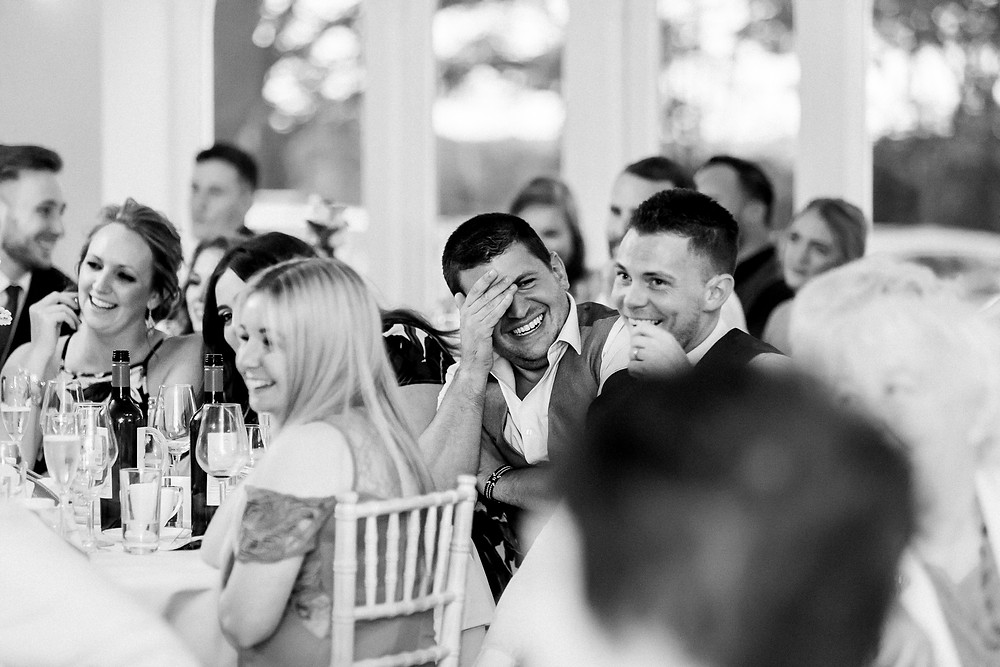guests laugh at wedding