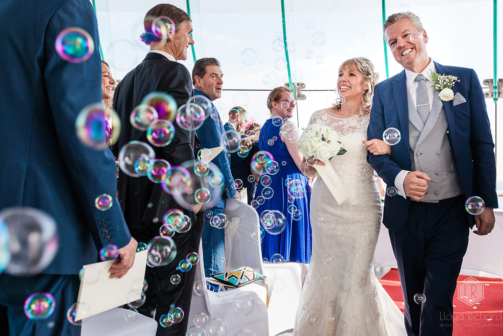 Walking down the aisle at spinnaker tower wedding