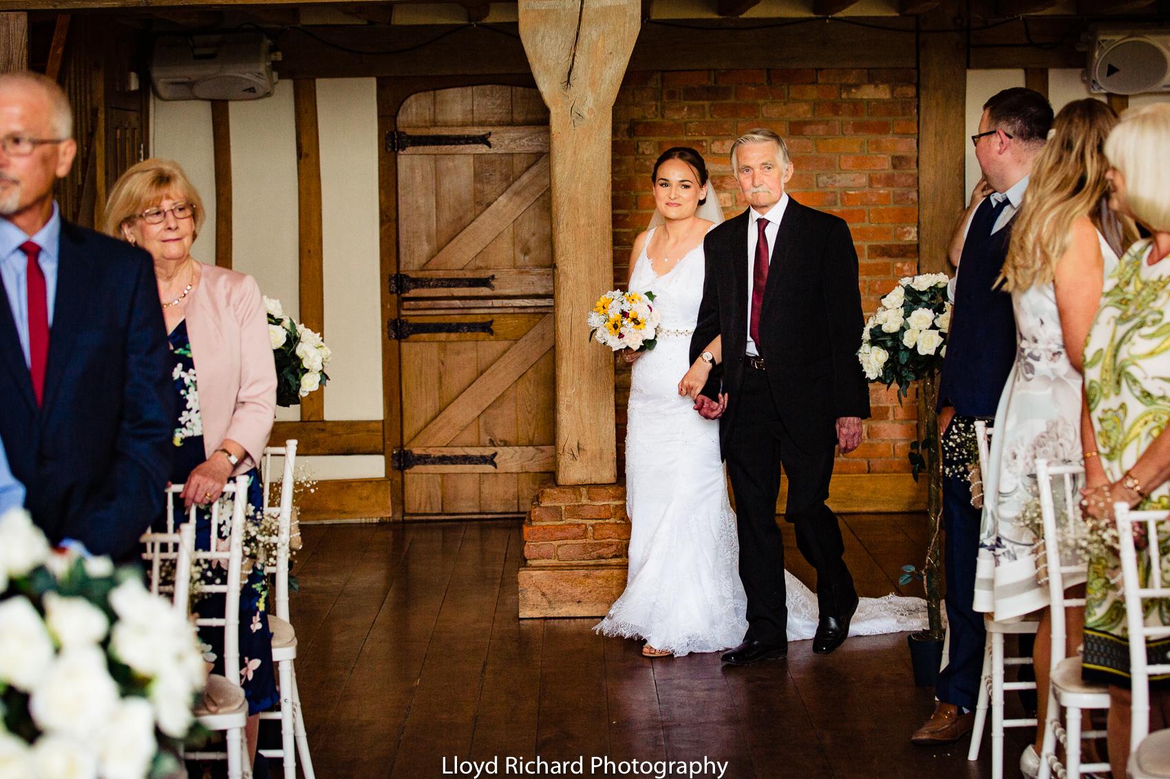 bride walking down the aisle at Cain Manor