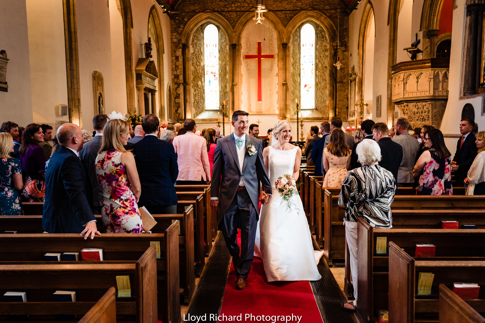bride and groom walking out of the Beaulieu Abbey Domus