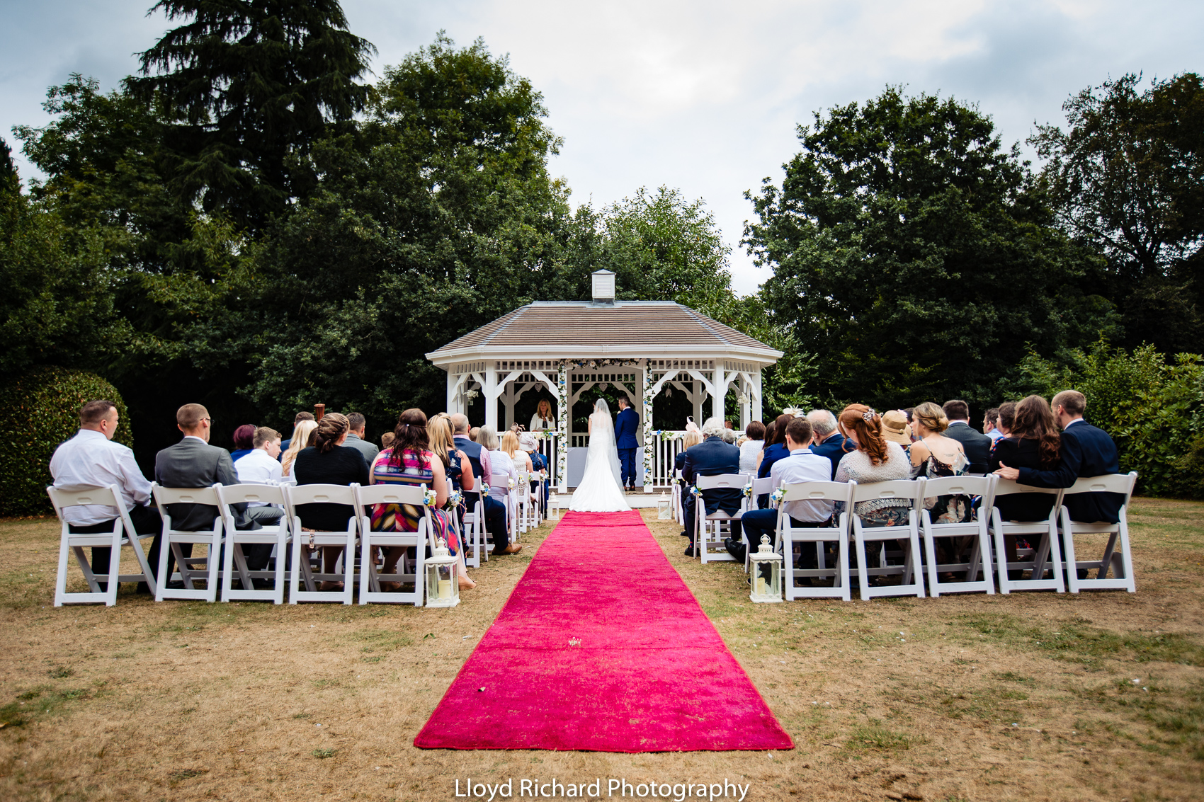 wedding ceremony outside at Moorhill House Hotel new forest