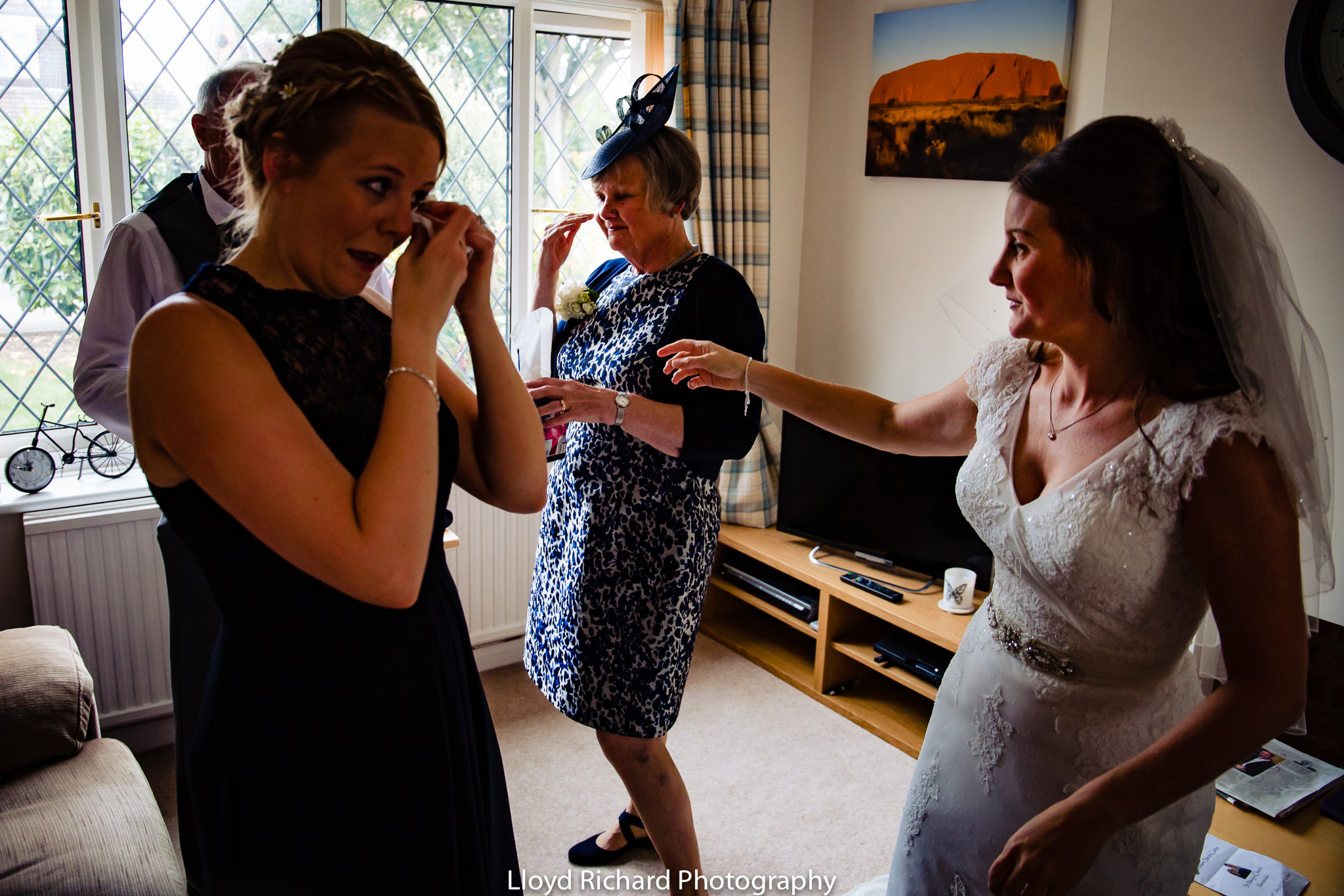 bridesmaid crying with bride