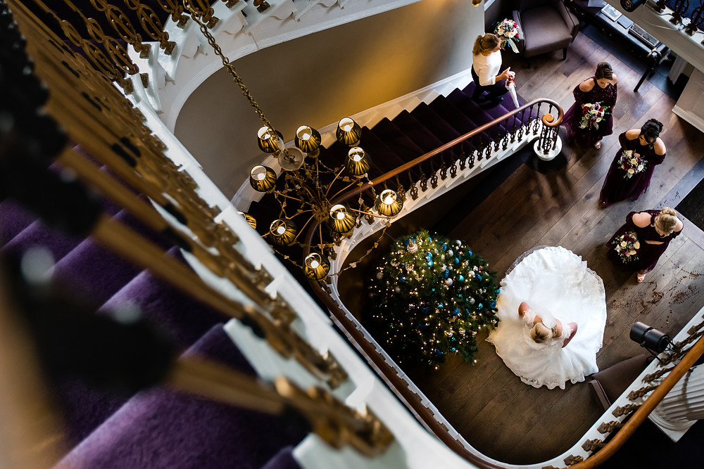 flowing central staircases at wedding