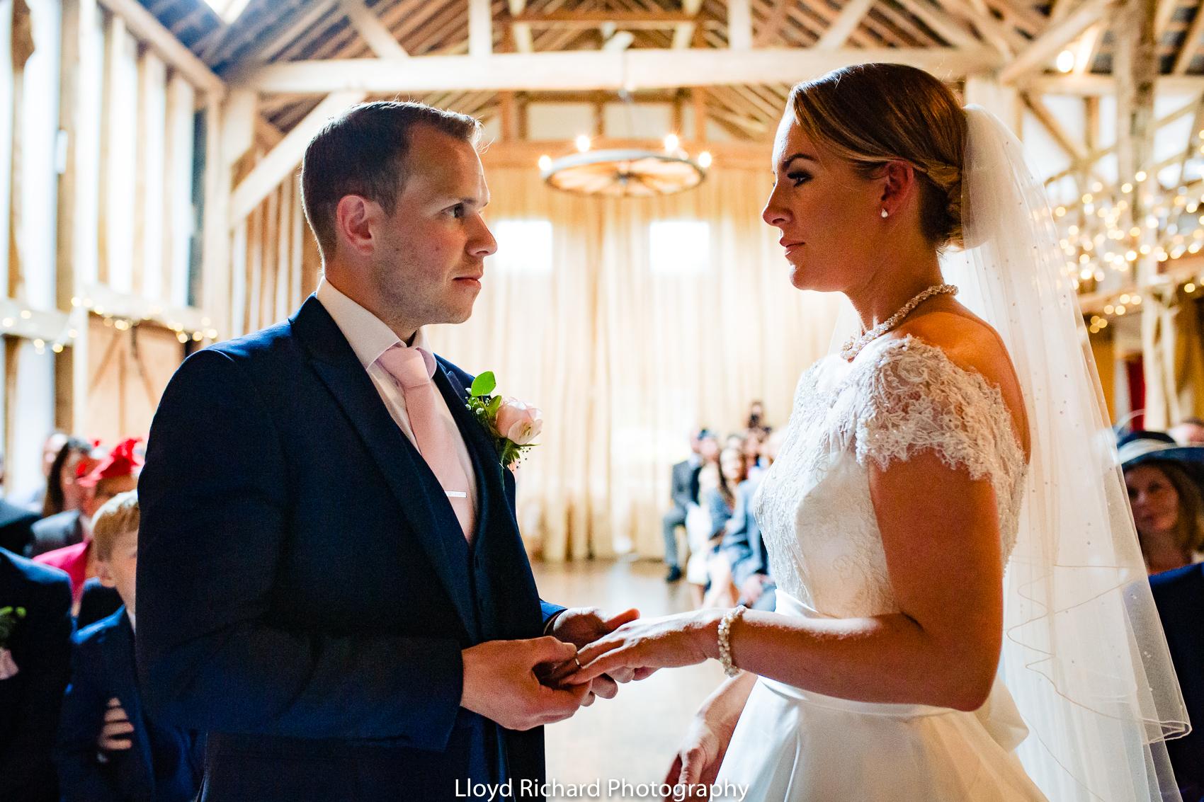 groom exchanging ring at Pitt Hall Barn