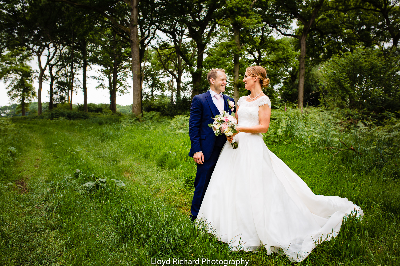 bride and groom having wedding photos at Pitt Hall Barn