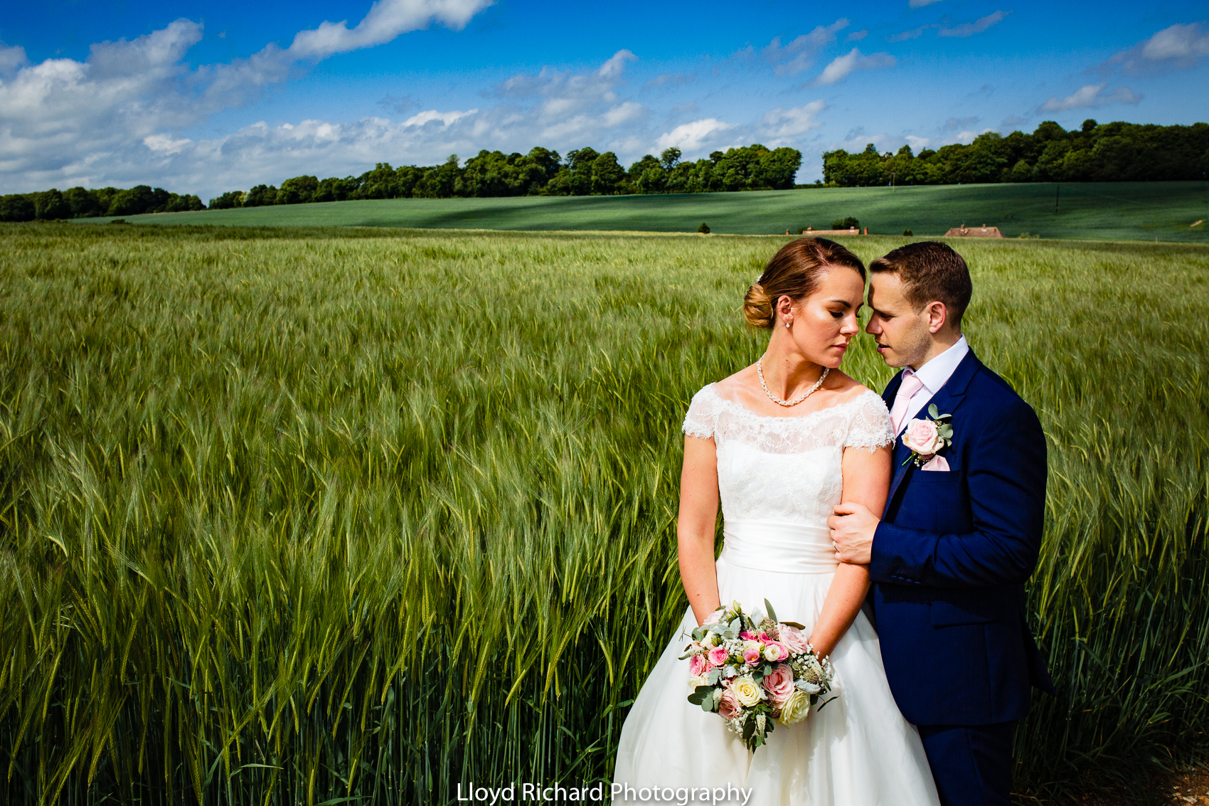bride and groom in a field at Pitt Hall Barn