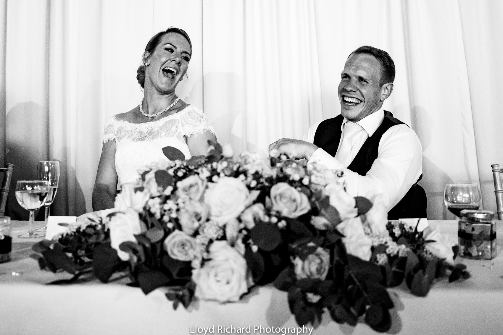 bride and groom laughing at Pitt Hall Barn