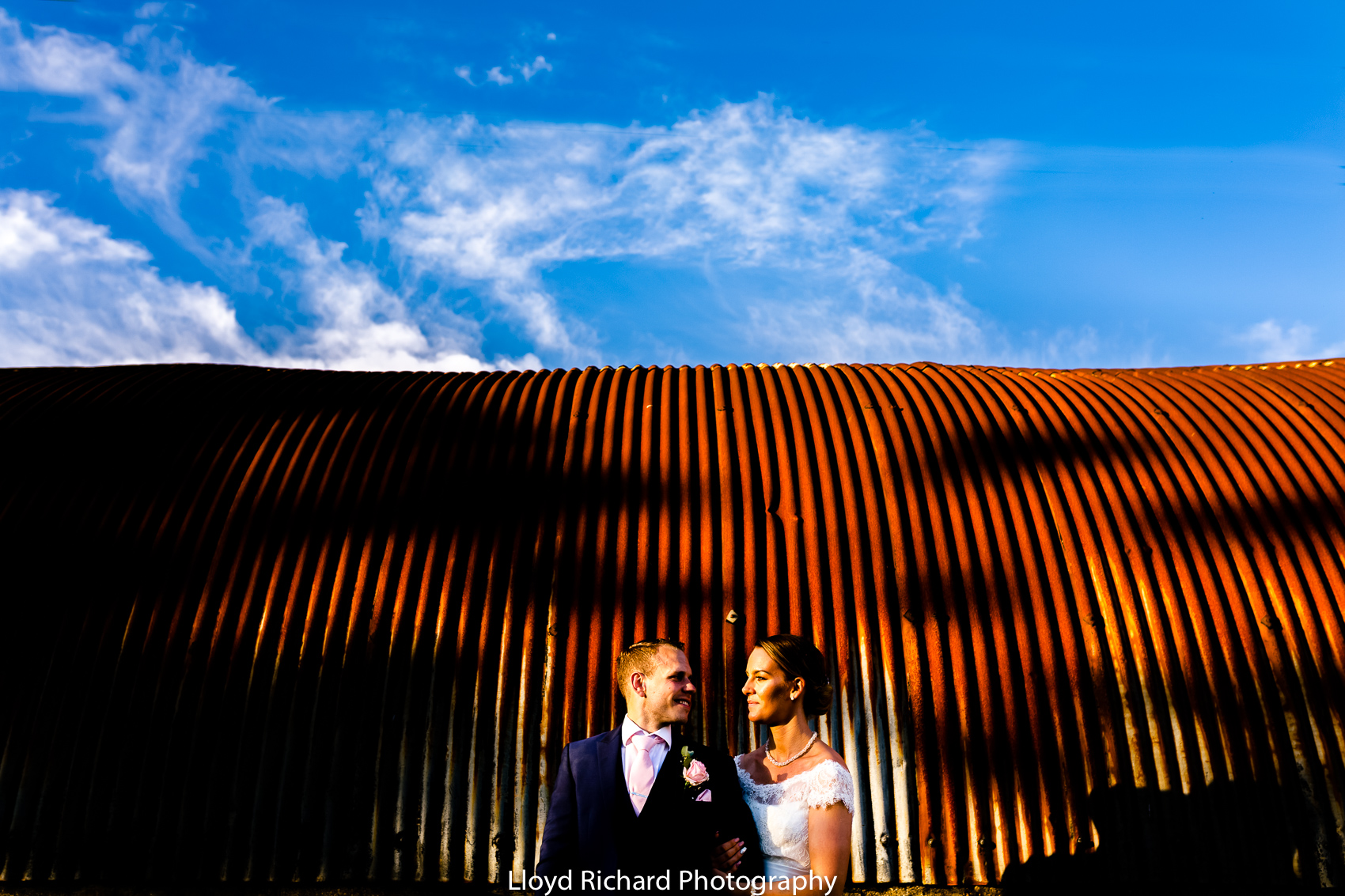 bride and groom having wedding photos on the farm at Pitt Hall Barn