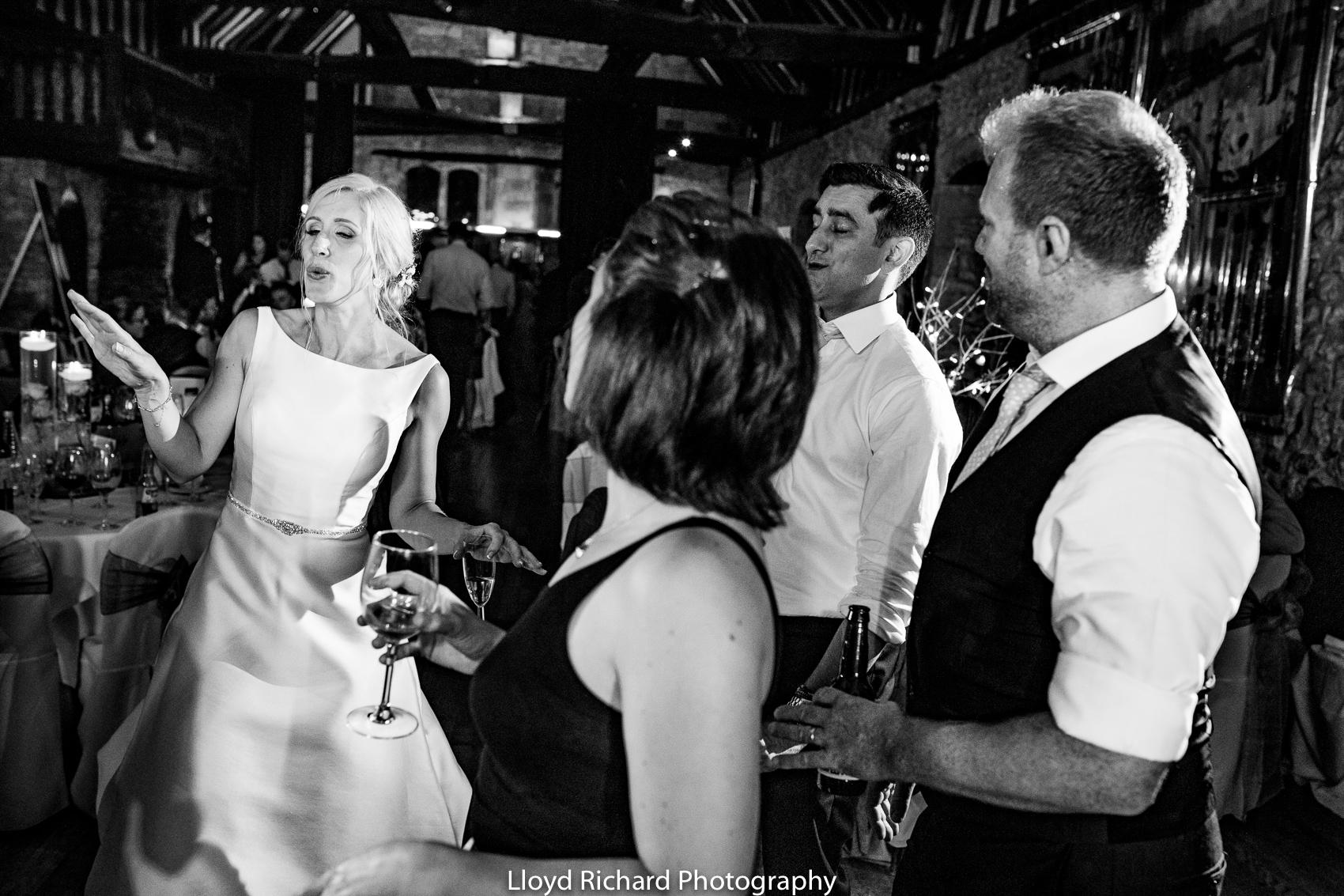 Bride dancing at wedding guest dancing Beaulieu Abbey Domus