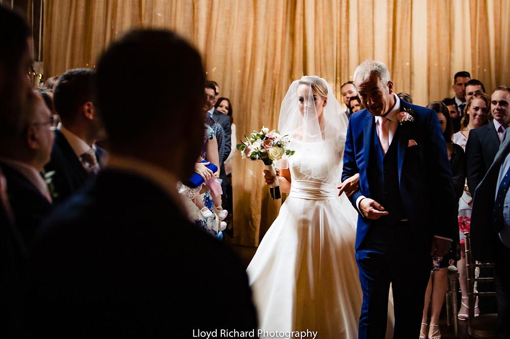 Bride walking down the aisle at Pitt Hall Barn