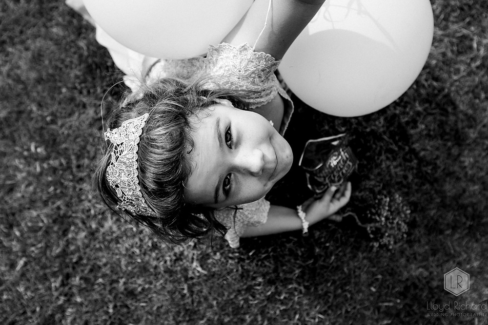 children at wedding playing with ballon
