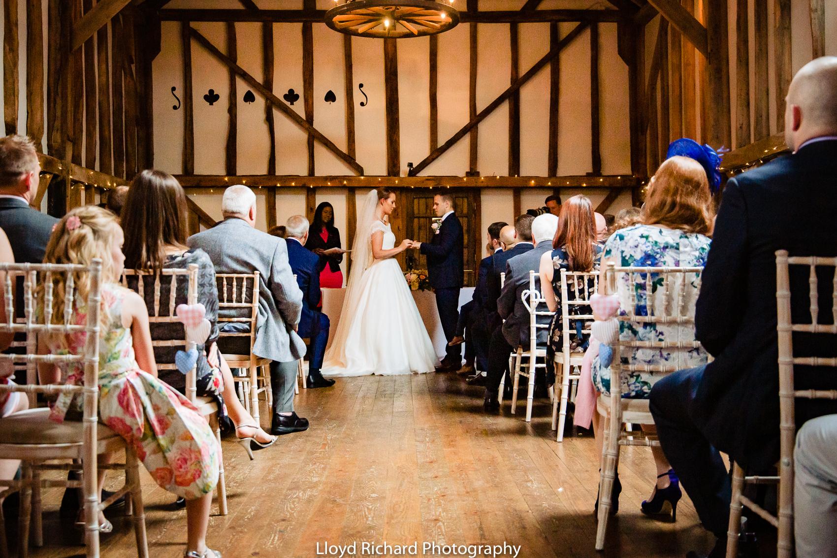 bride exchanging ring at Pitt Hall Barn