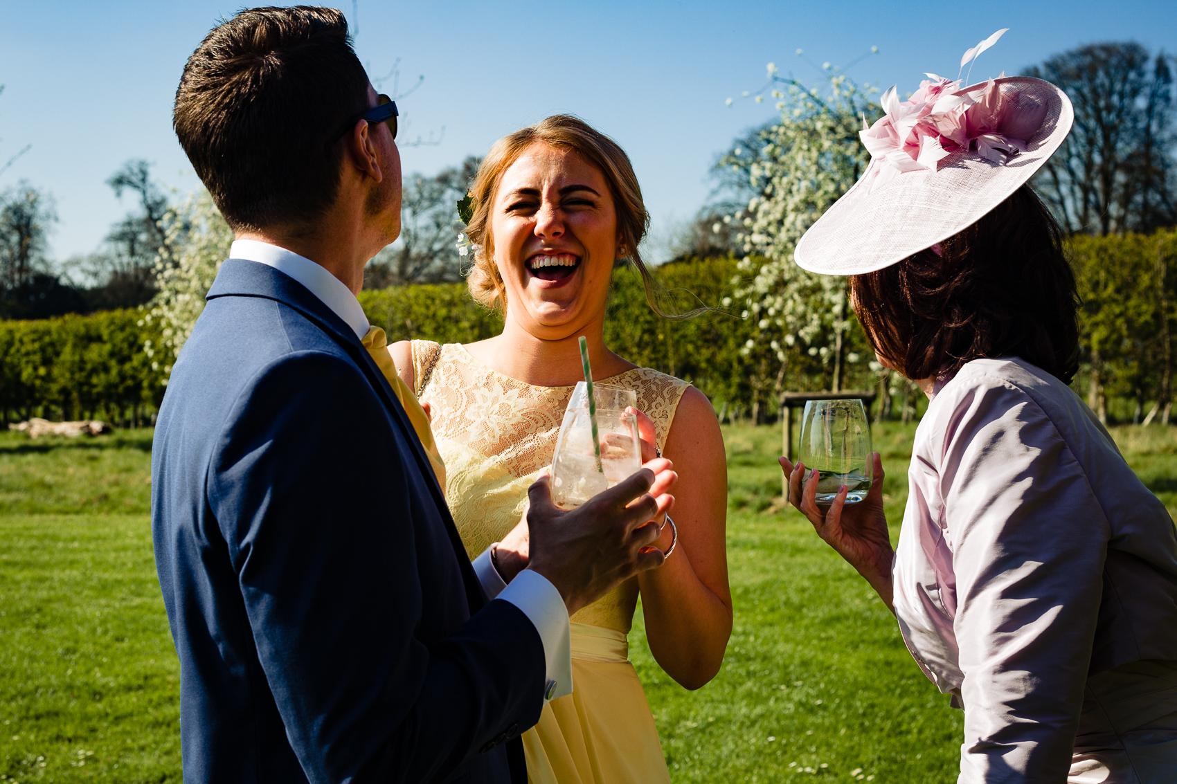 bridesmaid laughing at Clock Barn