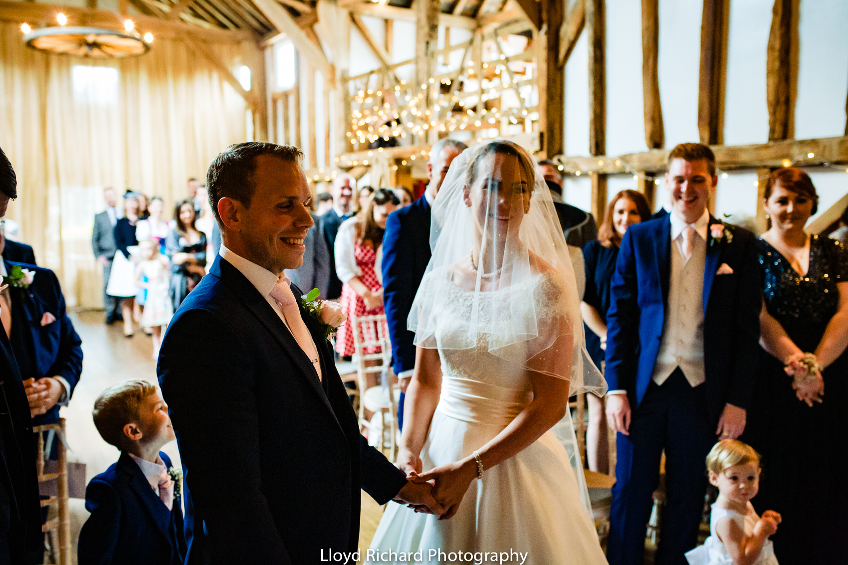 bride and groom saying vows at Pitt Hall Barn