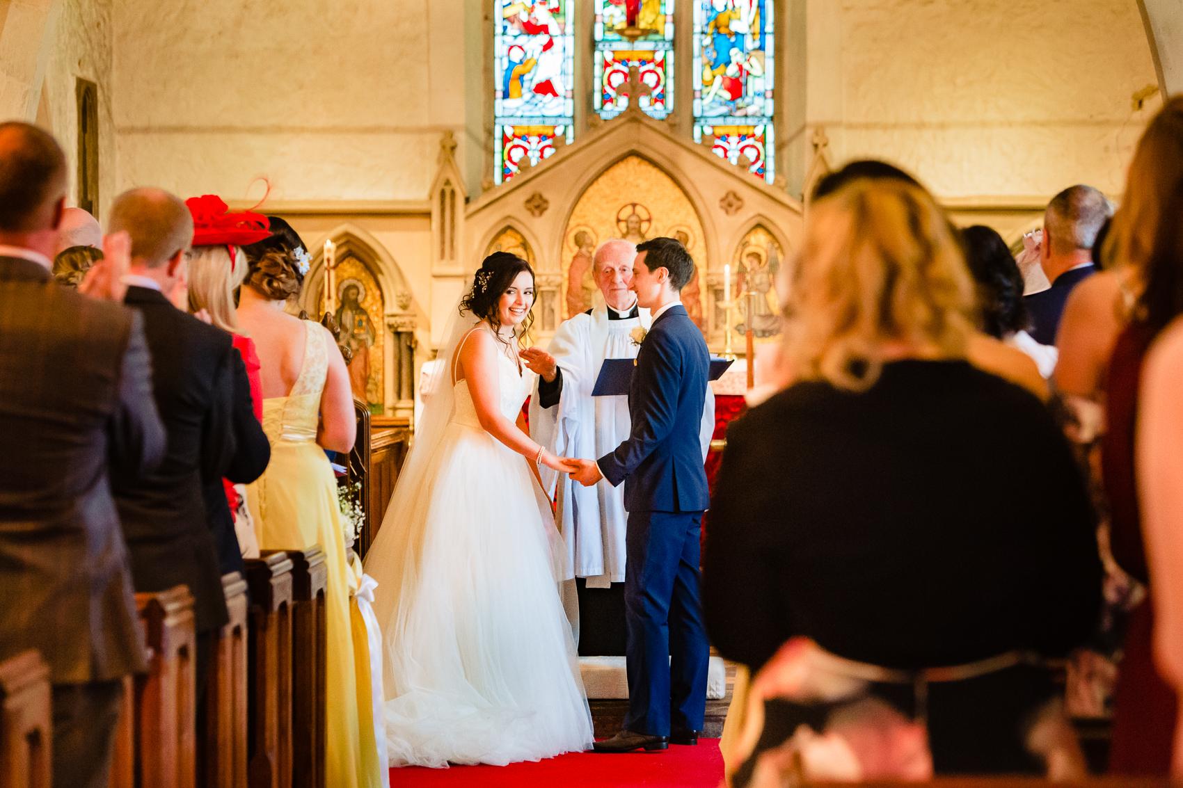 bride and groom at St Leonard's Church Sherfield on Loddon
