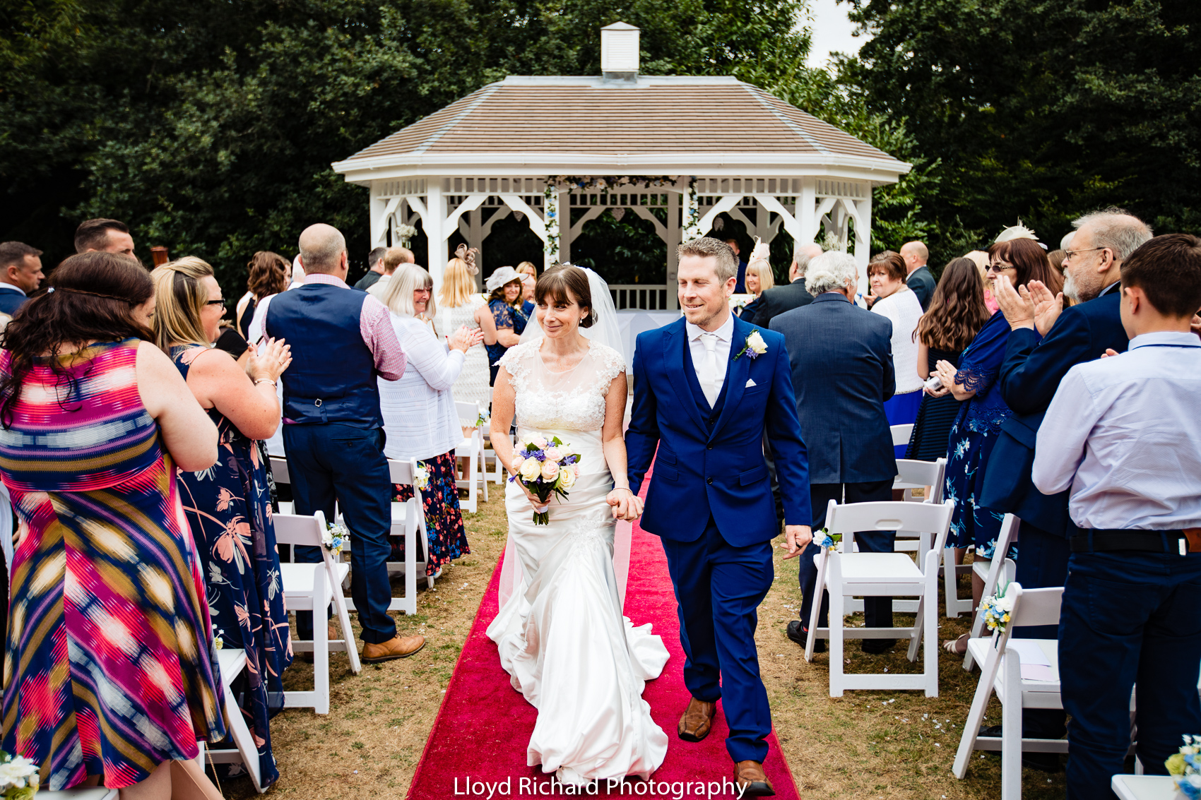 bride and groom walking down the aisle in the garden at Moorhill House Hotel wedding