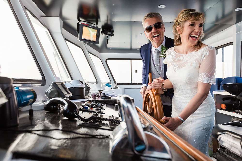 Bride and groom driving a boat