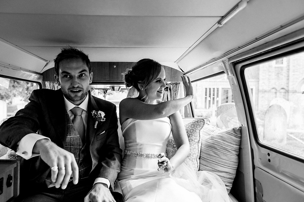 bride and groom leaving in a VW camper
