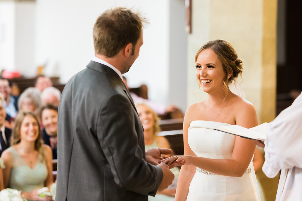 exchange of rings, bride laughing