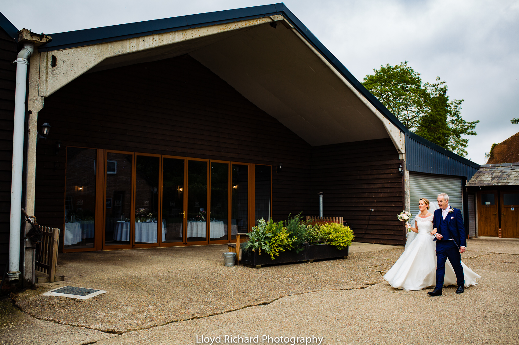 bride holding fathers arm at Pitt Hall Barn