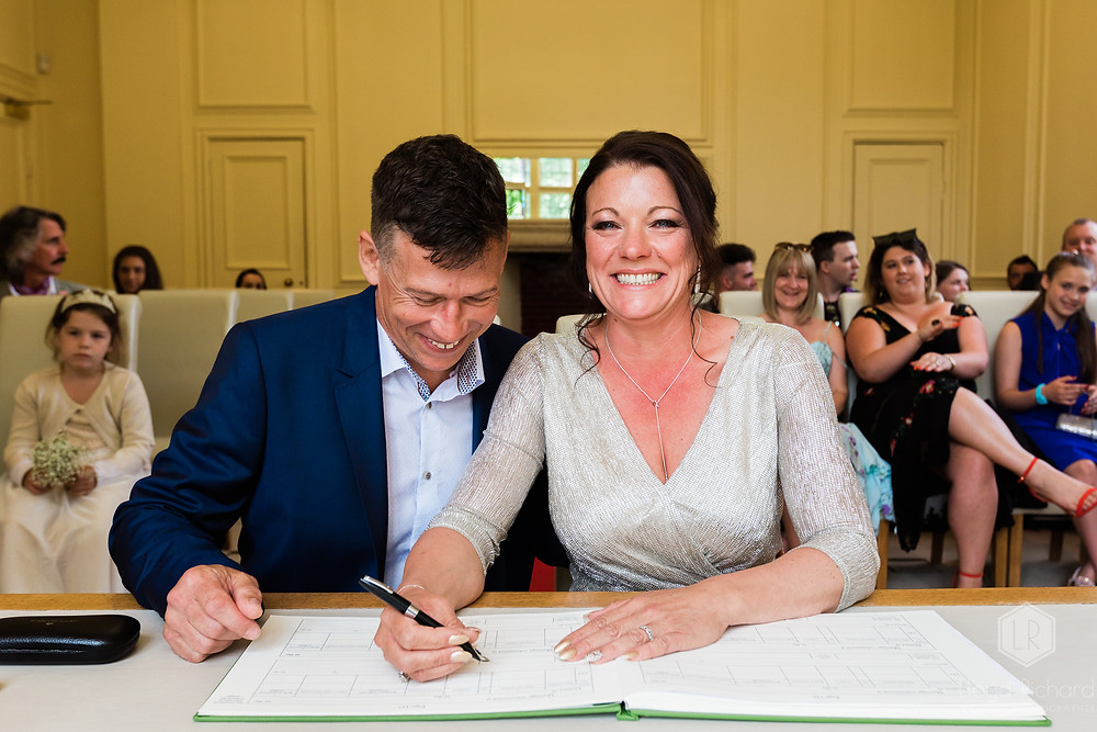 signing the register at Shaw House Wedding