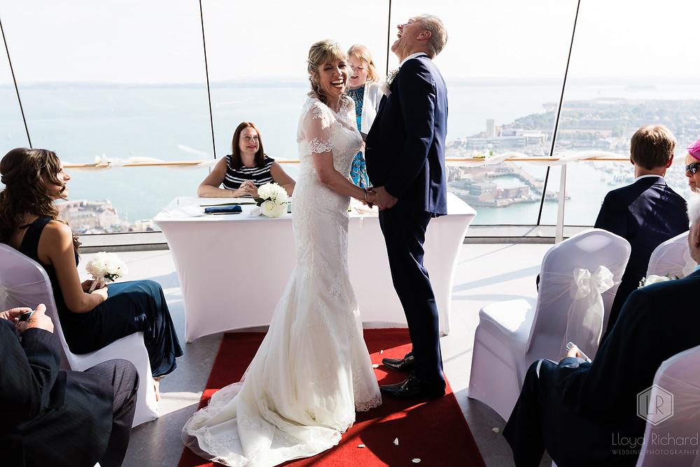 couple laughing at spinnkaer tower wedding