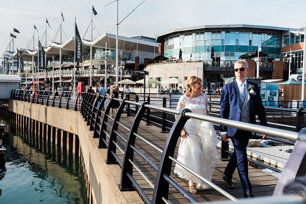 Bride and groom walking through GunWharf