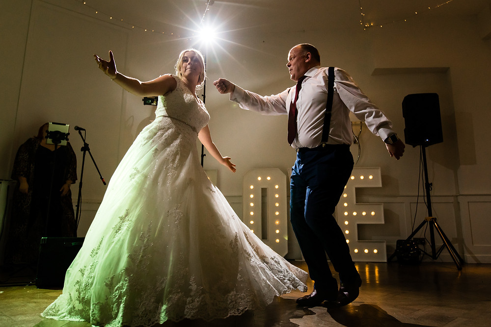 Father and daughter dance at harbour hotel