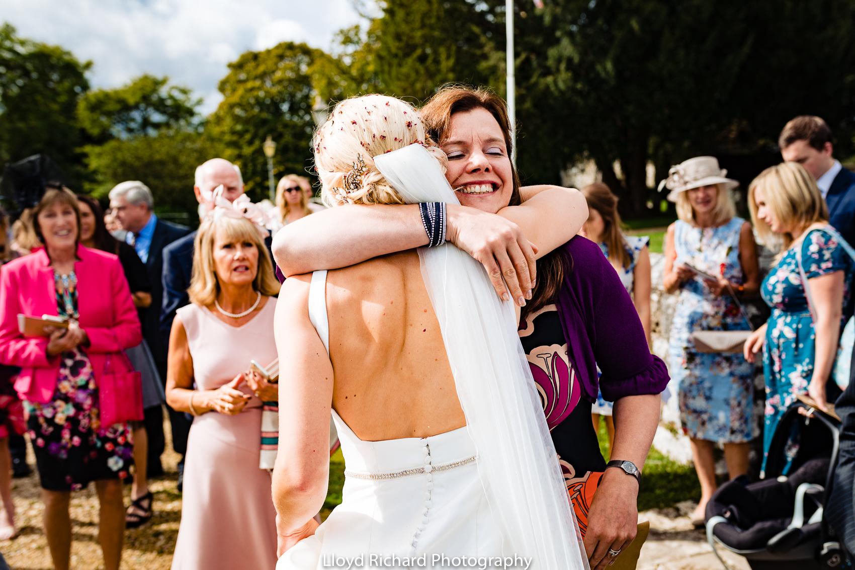 wedding guest hugging bride at Beaulieu Abbey Domus