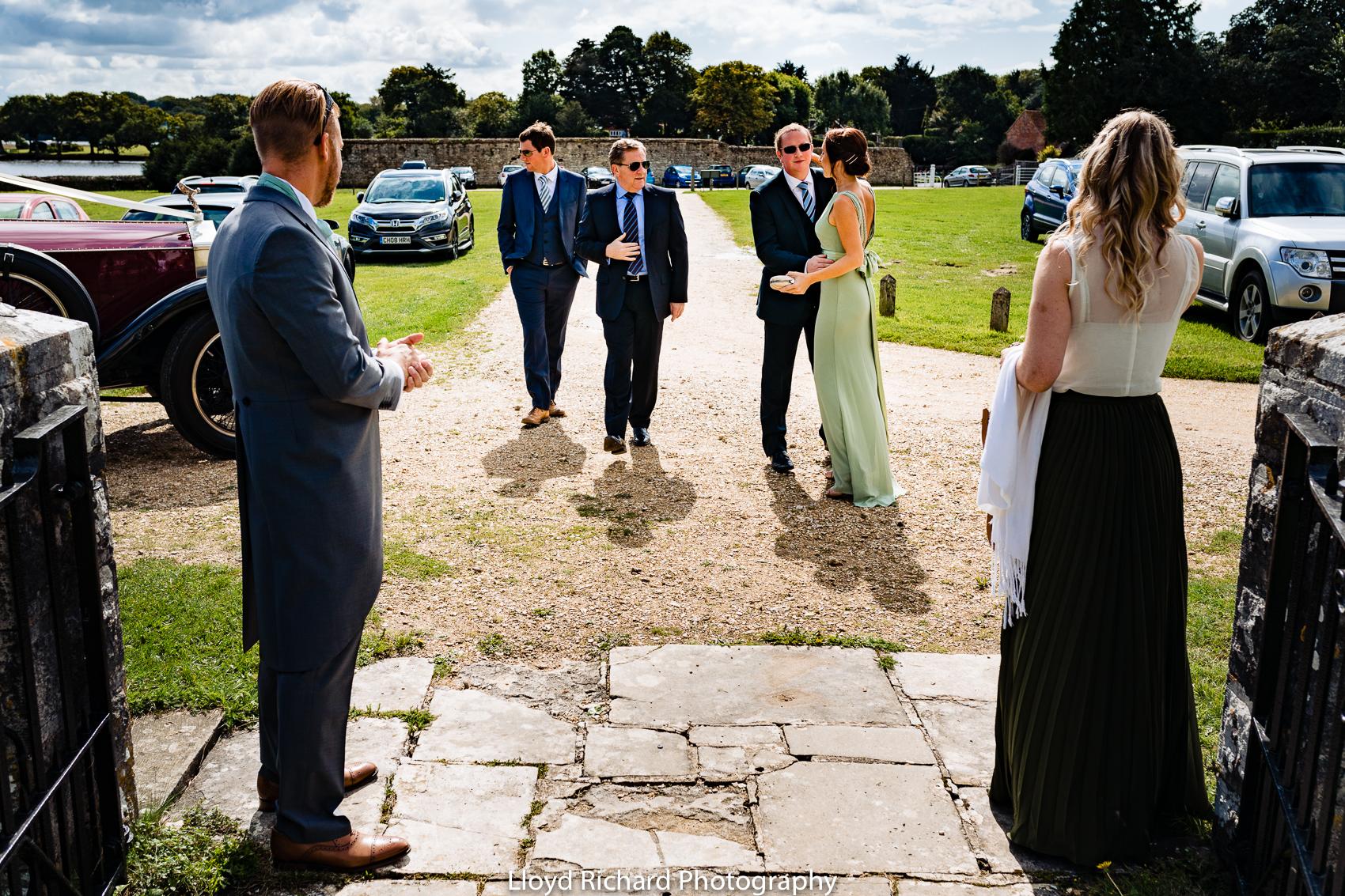 wedding guest arriving at Beaulieu Abbey Domus