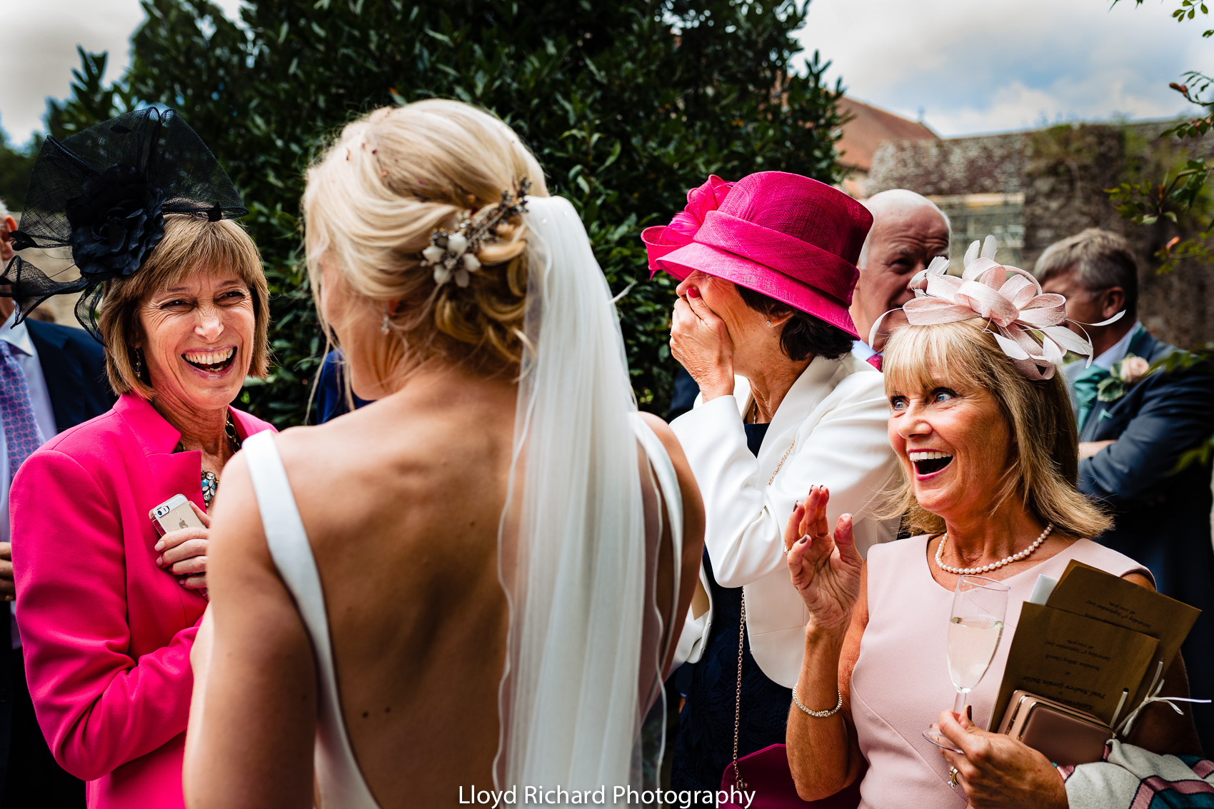 wedding guest laughing at Beaulieu Abbey Domus