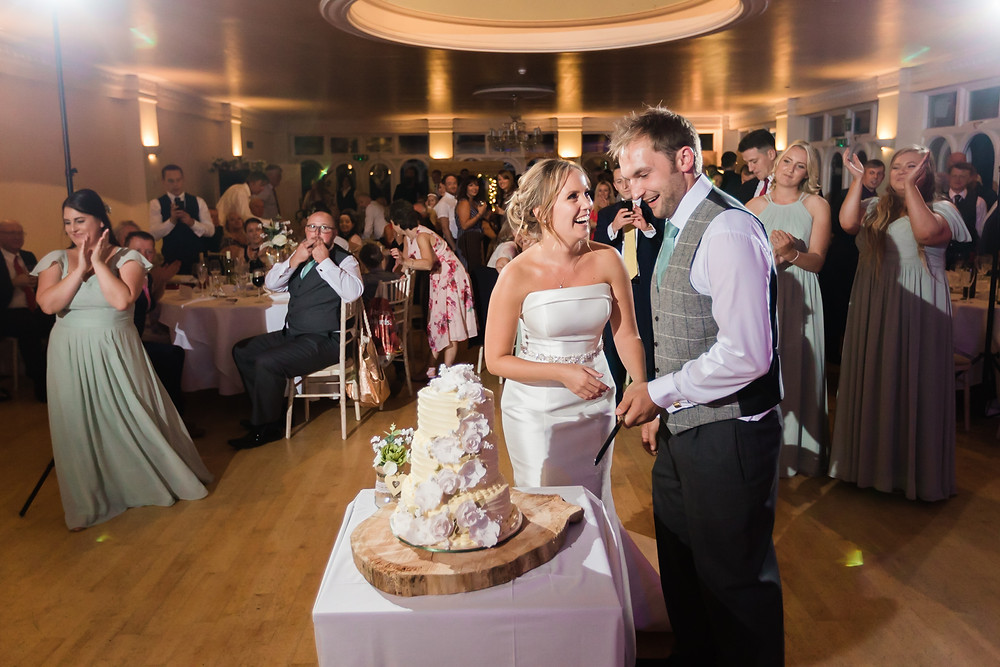 cake cutting at Wedding Reception at Rookesbury Park, Wickham