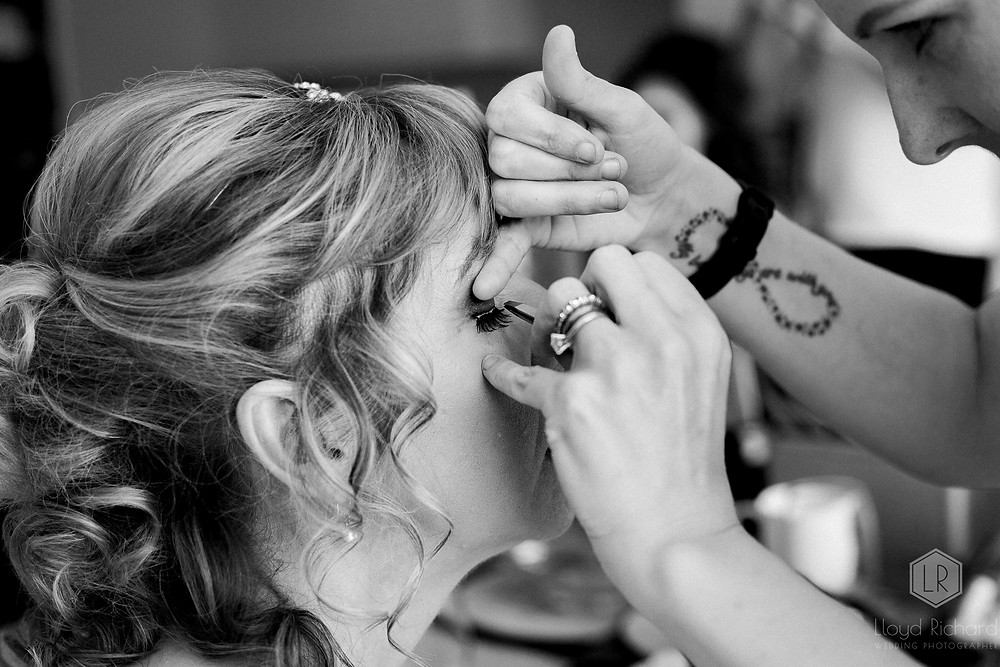 brides eyelashes being put on