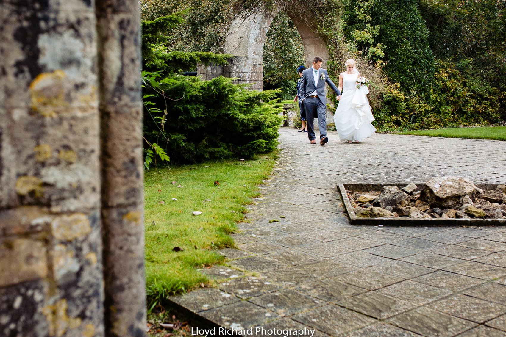 wedding couple walking through Beaulieu Abbey Domus