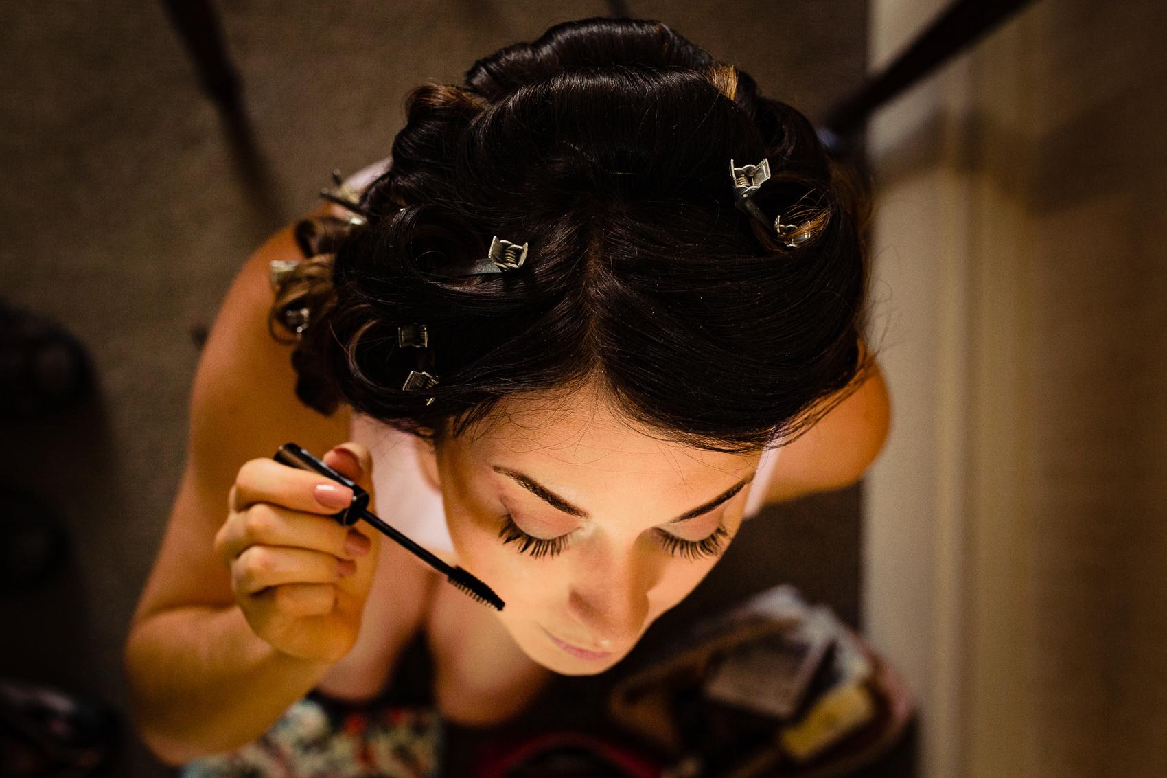 bridesmaid putting on make-up at Audleys Wood Jane Austen Suite