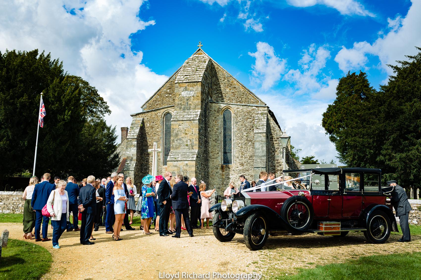 wedding guest outside Beaulieu Abbey Domus