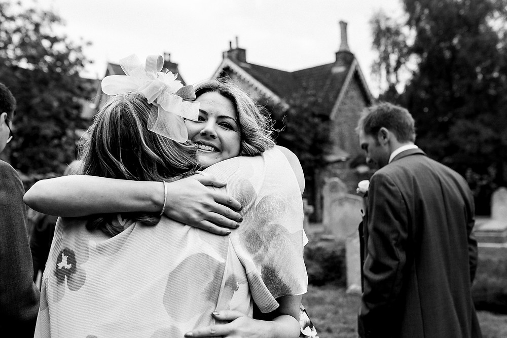 wedding guest hugging