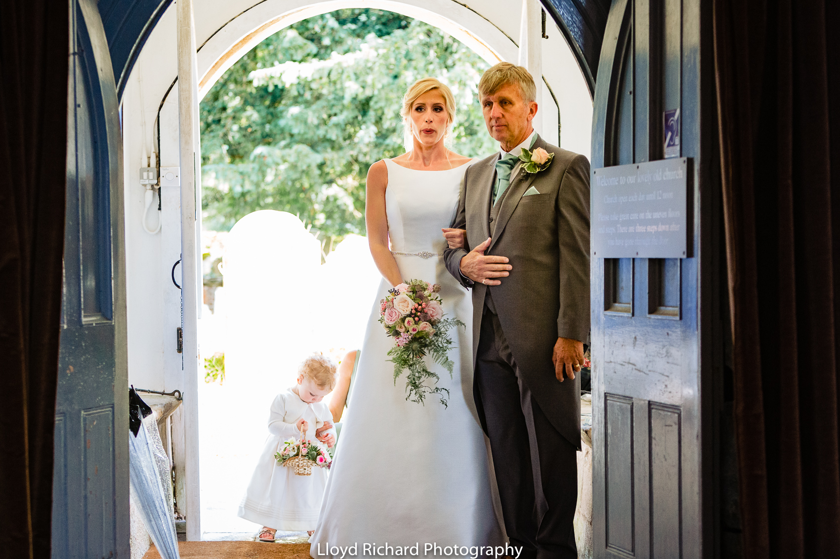 bride and father waiting to go in to Beaulieu Abbey Domus
