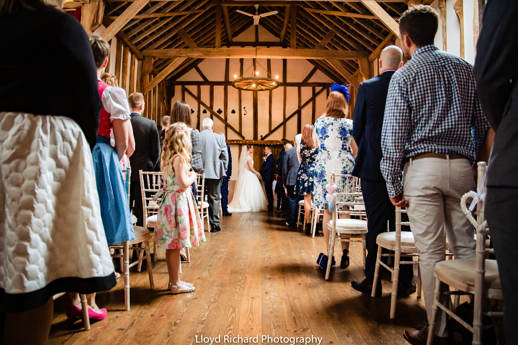 bride and groom exchanging rings at Pitt Hall Barn