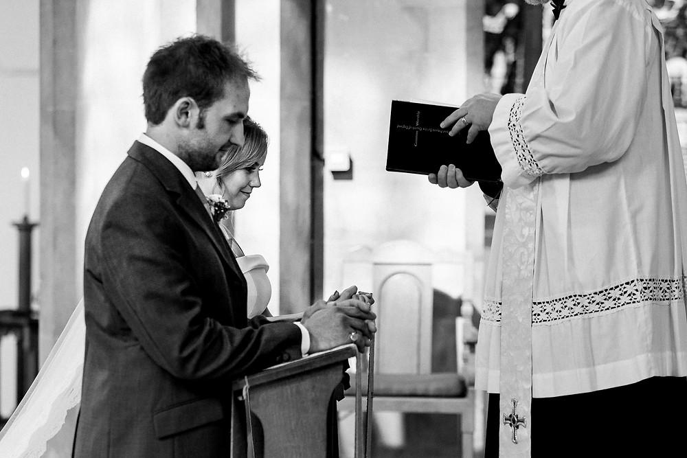 bride and groom taking prayer