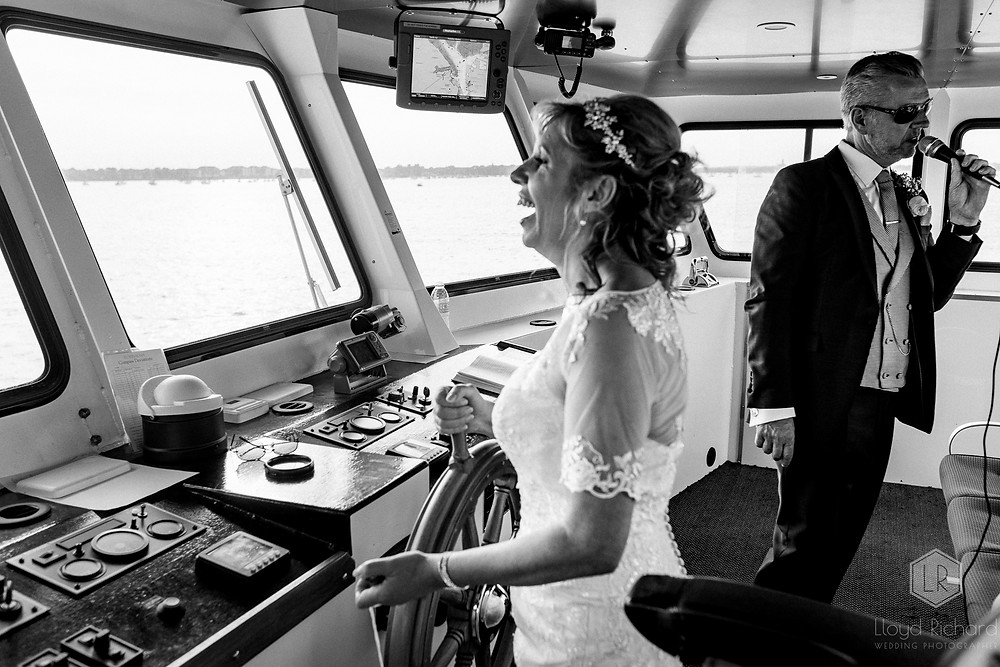 bride driving the boat at a wedding