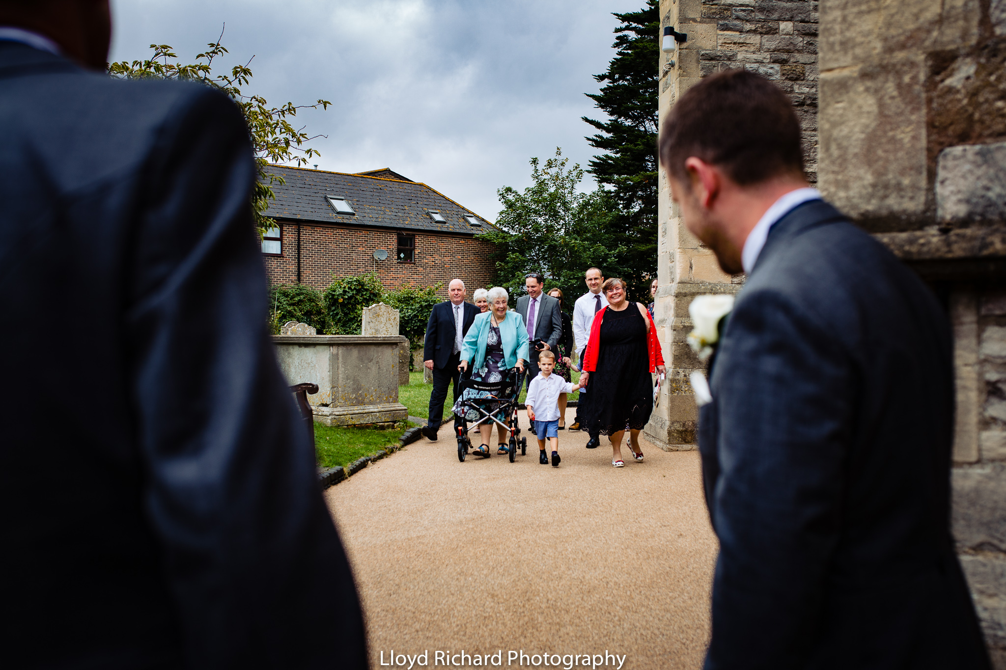wedding guests walking to church